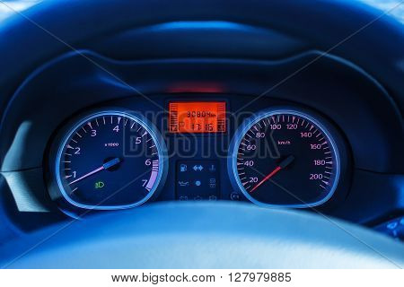 tachometer of a modern car blur focus evening light