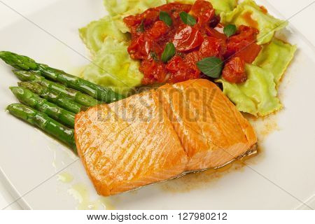 Salmon Grilled And Ravioli And Red Sauce
