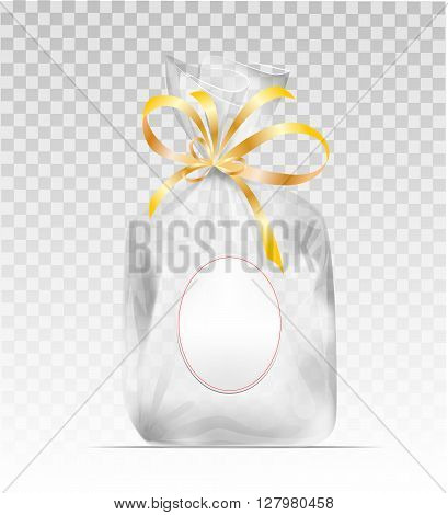 Empty Transparent plastic gift bag with gold shiny ribbon