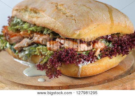 Tasty Salmon Steak Sandwich In A Ciabatta