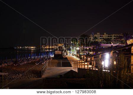Beautiful seashore at night pedestrian sidewalk on seashore