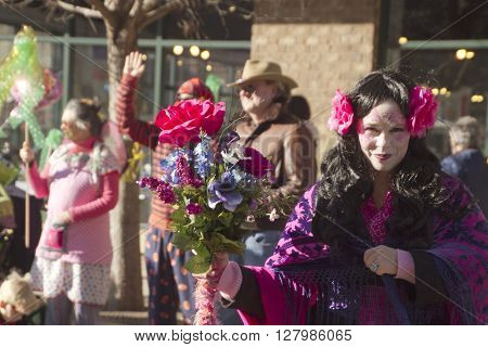 Asheville, North Carolina, USA - February 7, 2016: Vivid and colorful Mardi Gras characters and flowers in the annual Mardi Gras parade