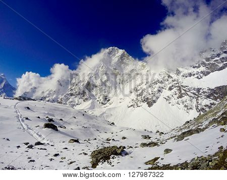 White mountains, sunny day and clear blue sky, snow and ice,  trek to Everest Base Camp, Nepal