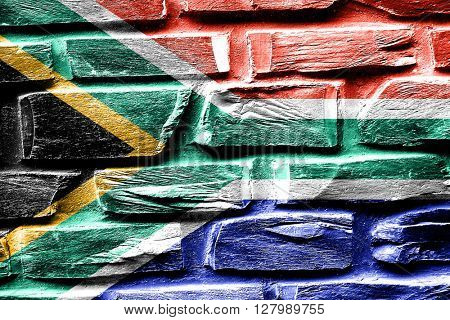 Brick wall South africa flag with some cracks and vintage look