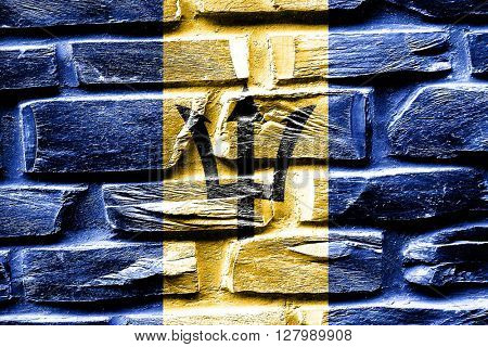 Brick wall Barbados flag with some cracks and vintage look