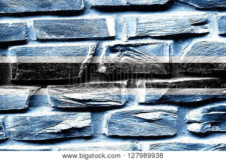 Brick wall Botswana flag with some cracks and vintage look