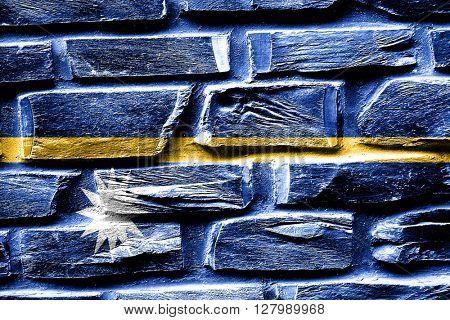 Brick wall Nauru flag with some cracks and vintage look