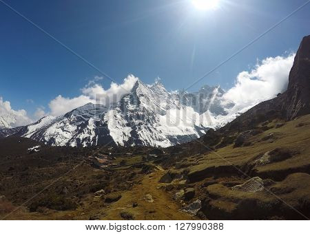 Himalayan landscape, sunny day in peaceful valley with village and farms, Sagarmatha national park, Nepal