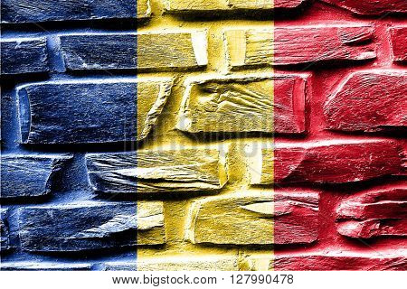 Brick wall Romania flag with some cracks and vintage look
