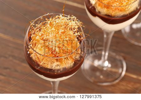Tiramisu In The Glass On The Wooden Background