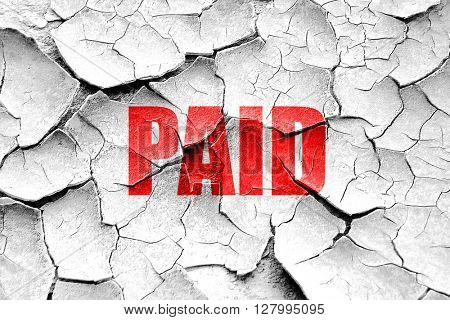Grunge cracked paid sign background
