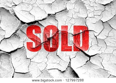 Grunge cracked sold sign background