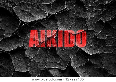 Grunge cracked aikido sign background