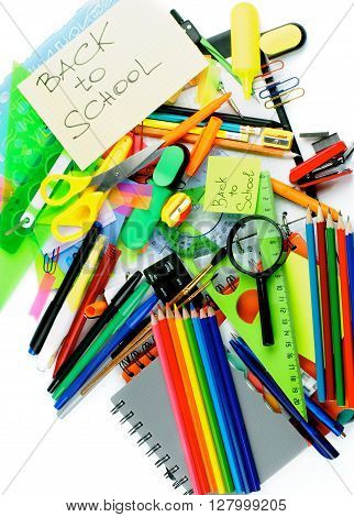 Back to School Concept with Various Stationery Items Paint Brushes Felt In Pens Erasers Note Pads and Lines closeup on white background