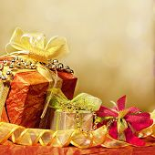 picture of christmas-present  - Christmas presents with colorful lights and decorations - JPG