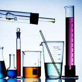 Flask with chemicals and test tubes over isolated background