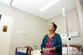 Senior Lady Patient In Hospital Ward