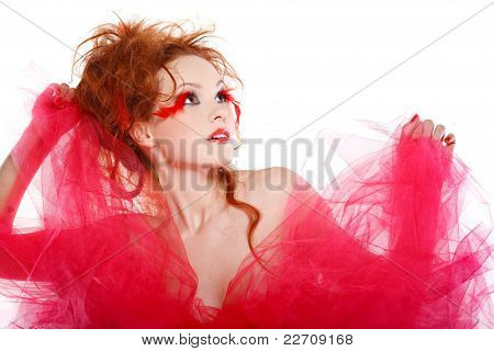 Beautiful Redheaded Girl With Red Feathers