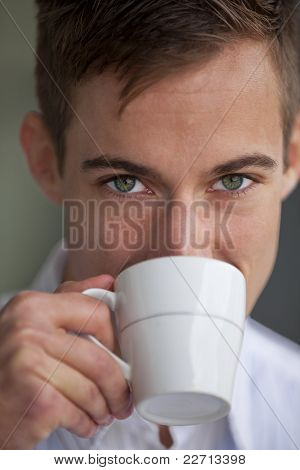 young man drinking something