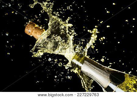 poster of Close Up Image Of Champagne Cork Flying Out Of Champagne Bottle. Celebration Theme With Explosion Of