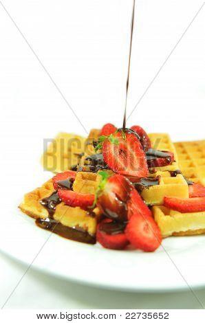 Strawberries and chocolate waffles