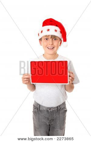 Boy With Christmas Message Or Sign