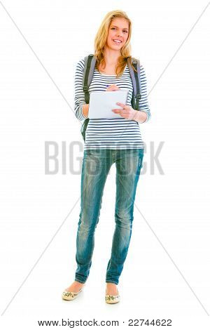 Full Length Portrait Of Smiling Teengirl With Schoolbag Writing In Notebook