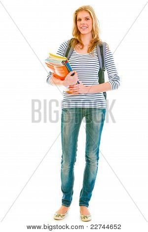 Full Length Portrait Of Smiling Pretty Teen With Backpack And Schoolbooks