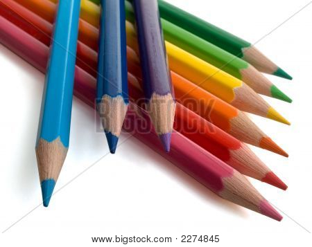 The Multi-Coloured Pencils Lay On A White Background