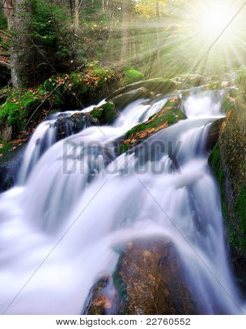 autumn waterfall in the national park Sumava-Czech Republic