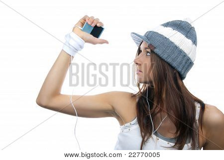 Young Girl Listening, Enjoying Music And Holding Cellular Mp3 Playe