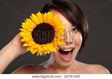 Beautiful Happy Young Girl Sunflower To Her Face