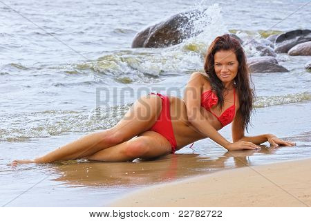Beautiful Woman In Bikini At The Sea Takes Sunbath