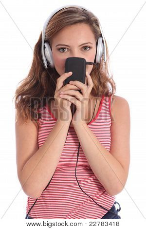 Cute Teenager Girl Listens To Music On Headphones