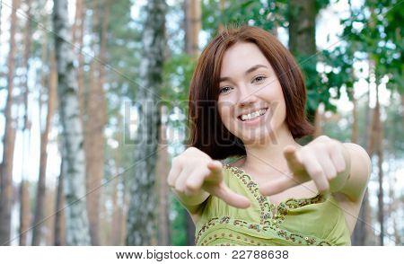 Girl pointing at camera at the park