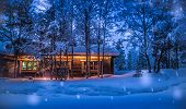 Romantic View Of Old Traditional Wooden Forest Cabin In The Woods Embedded In Scenic Northern Winter poster