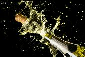 Close Up Image Of Champagne Cork Flying Out Of Champagne Bottle. Celebration Theme With Explosion Of poster