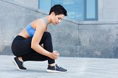 Young Woman Tying Shoes Laces Before Running, Getting Ready For Jogging In Park, Closeup, Copy Space poster