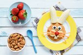 Healthy Easter Breakfast For Kids. Easter Bunny Shaped Pancake With Fruits. Top View poster