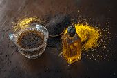 Brown Mustard Seeds,mustard Seeds Oil/tea And Crushed Mustard Seeds On The Brown Wooden Surface.its poster
