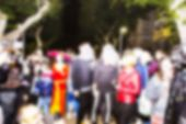 Abstract Blurred Background. People Dressed As A Zombie Parades On A Street During A Zombie Walk poster