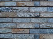 Slate Tile Brick Work Background Photograph. Rough Cut Textured Slate Stone Brick Shaped Tiles. Natu poster