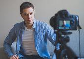 Handsome Man Making Video Blog. Concept Of Blogging. poster