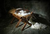 stock photo of manger  - The story of Christmas metaphor represented by a manger and crown of thorns - JPG