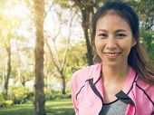 Close Up Of A Happy Young Asian Woman Warming Up Her Body By Stretching Her Body Before Morning Exer poster