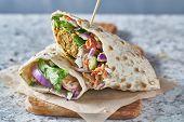 vegan food- tasty falafel wrap in gluten free bread poster