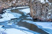 Постер, плакат: mountain river in winter scenery Cache la Poudre River in northern Colorado