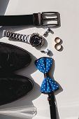 Wedding Rings. Black Leather Shoes, Watch, Blue Bow Tie And Cufflinks, On A White Window Sill. Acces poster