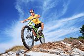 A young male riding a mountain bike outdoor