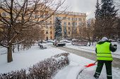Tractor Cleaning The Road From The Snow. Excavator Cleans The Streets Of Large Amounts Of Snow In Ci poster